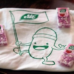 t-shirt with newest Tic Tac character on it and and three very large packages of the tasty new Strawberry Fusion Tic Tacs