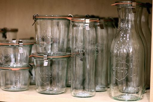 a collection of Weck jars or molded glass jars