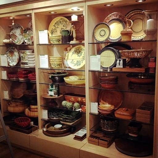 a wall with a collection of pie plates like Emile Henry artisan ruffled pie dishes