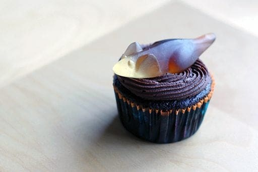 close up of Halloween Cupcake with icing and gummy mice on top