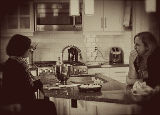 two women talking in the kitchen