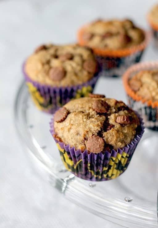 Peanut Butter Cup Banana Muffins on a glass tray