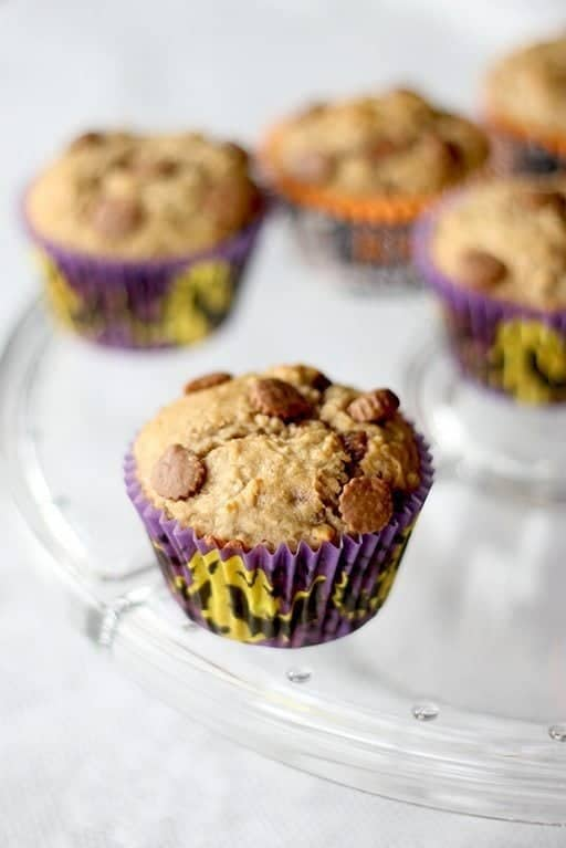 close up Peanut Butter Cup Banana Muffins in spooky muffin liners on a glass tray