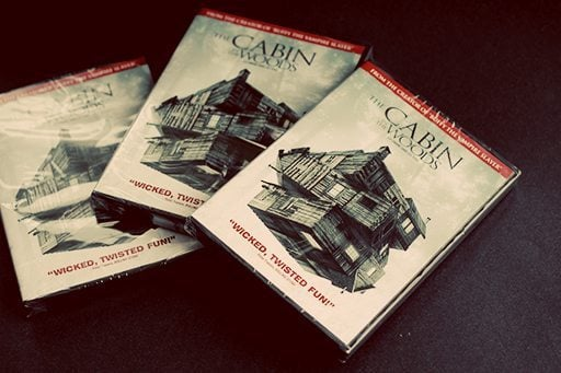 three copies of movie Cabin in the Woods