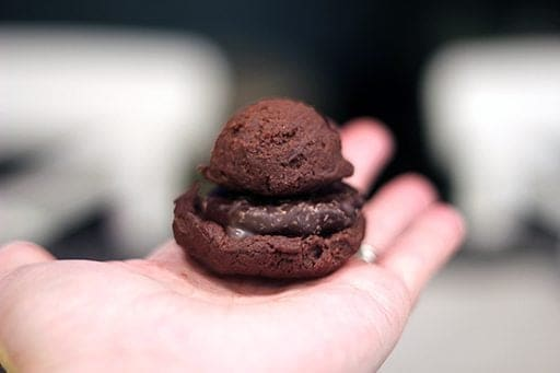 Double Mint Chocolate Chip Cookie dough being wrapped around a peppermint patty.