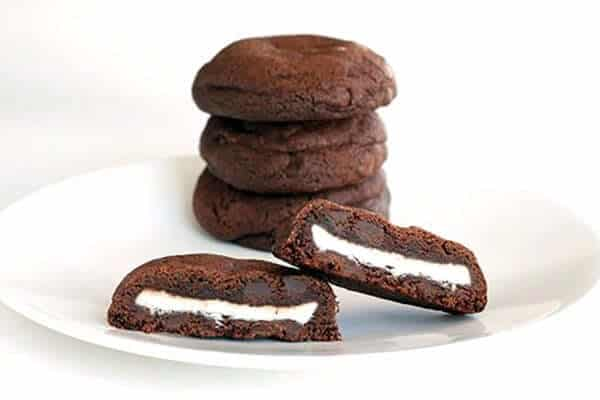 Stack of Double Mint Stuffed Chocolate Chip Cookies in a White Plate