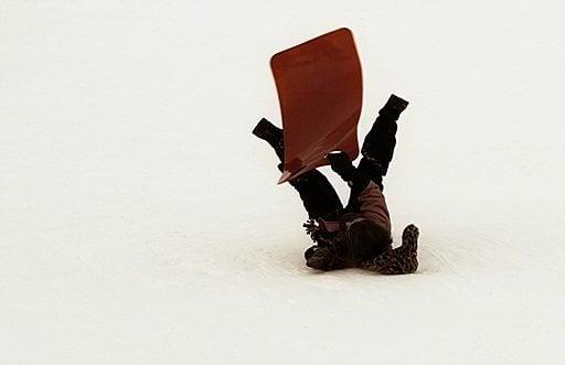 kid stumble in sled