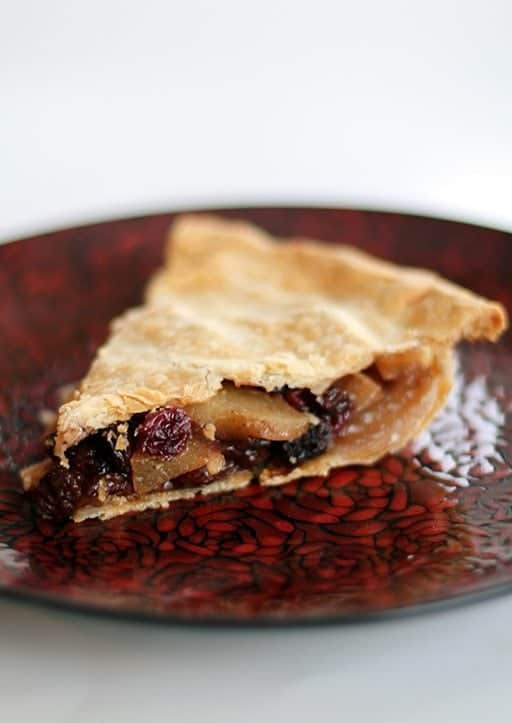close up slice of Winter Fruit Pie in a red plate