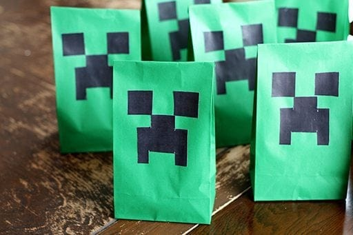 green treat bags designed with black creepers