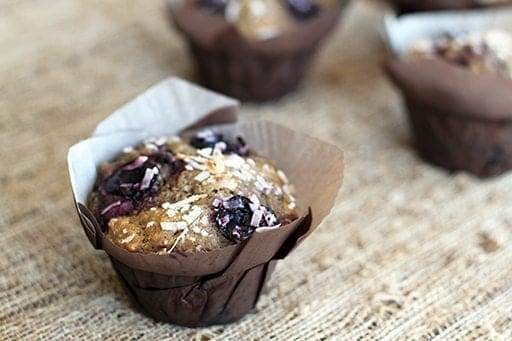close up of Cherry Coconut Whole Wheat Muffins with Brown Muffin Liners