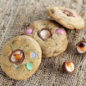 Three pieces leftover Easter Candy Cookies in fiber cloth background