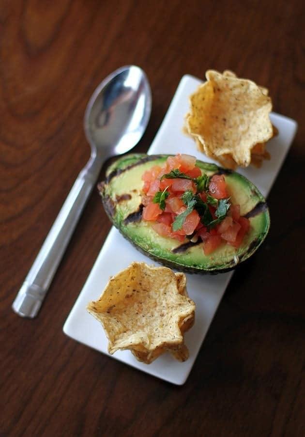Avocado Filled with the pico de gallo and cilantro, a spoon beside it