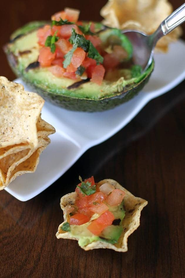 miniature bowl-shaped tortilla chips with grilled avocado & pico de gallo