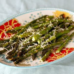 Close up of Roasted Garlic Asparagus With Sorvrano Cheese on Top