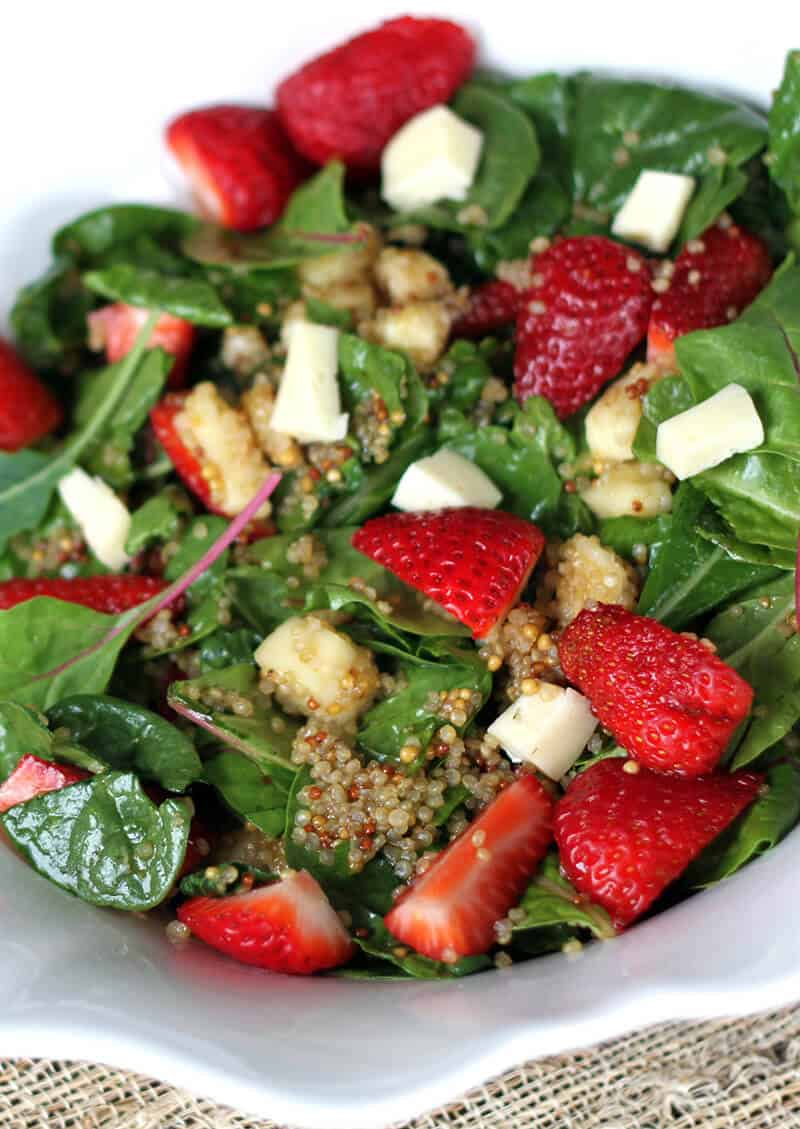 Close up of Strawberry Quinoa Salad With Brie and Brassica Mustard