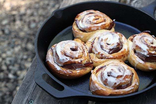 5 pieces Bacon Stuffed Cinnamon Buns in a Skillet