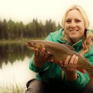 woman holding a freshly caught brook trout