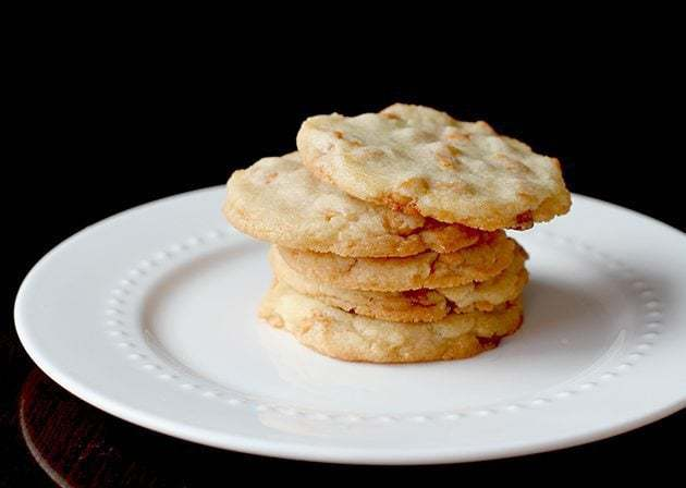 stack of Crispy Butterscotch Cookies in a white plate on black background