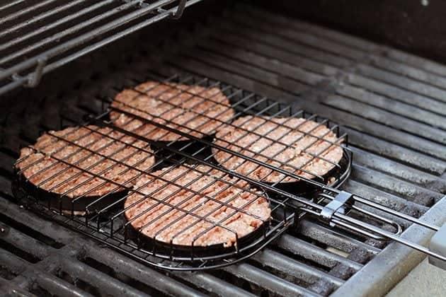 four pieces burger patties in william's sonoma hamburger grilling basket