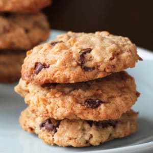 close up stack of Oatmeal Chocolate Chip Cookies in a white plate