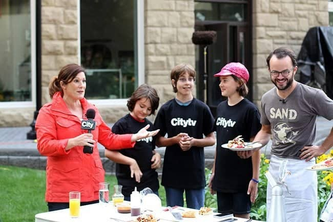 the host, chefs and the judges after it was announced it was a three-way tie