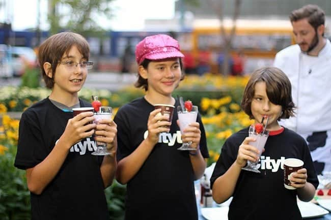 three young kids enjoying the smoothies