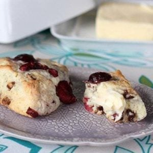 close up of three chocolate cherry scones in a plate