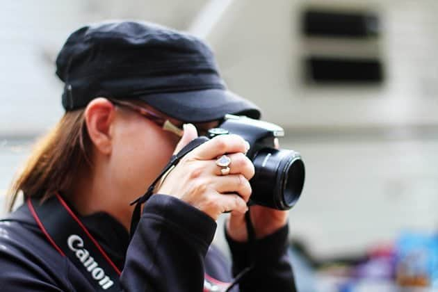 lady practicing shooting with camera