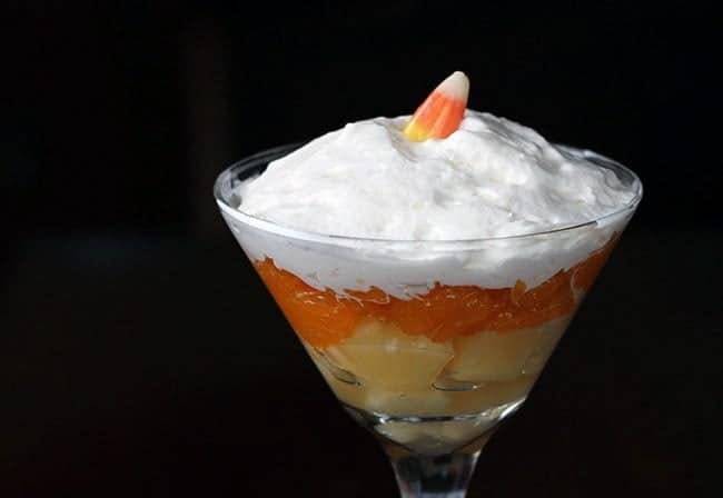 Candy Corn Fruit Martini - a layer of pineapple and mandarin oranges, top with whipped cream and a single candy corn on top.