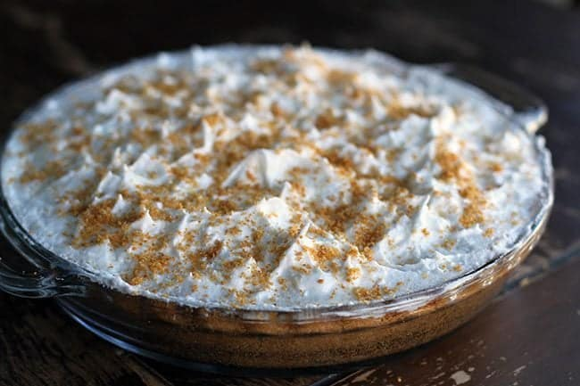 cinnamon laced graham crumbs on top of Flapper Pie with meringue