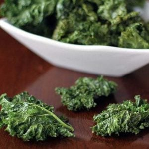 Crispy Kale Chips in a white square bowl