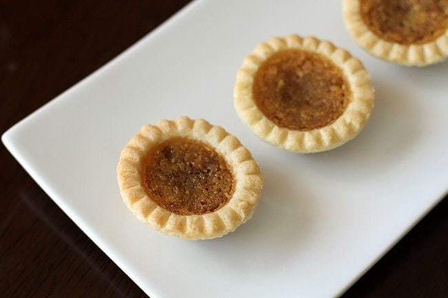 Treacle Tarts in a rectangular white plate