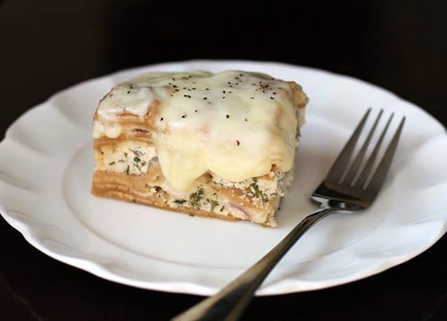 Creamy Chicken Alfredo Crockpot Lasagna in White Plate with Fork