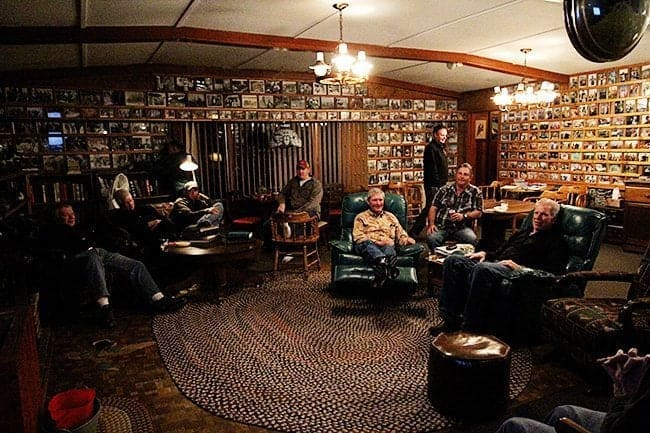 common room at Jimmy Robinson's Duck Lodge during night occupied by duck hunters