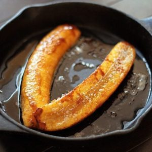 Fried Plantains in skillet with melted butter and sugar