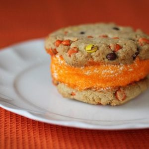 PB Halloween Ice Cream Sandwich Cookies in a middle of white plate in red background