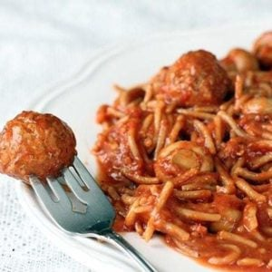Crock Pot Spaghetti & Meatballs in white Plate on White tablecloth