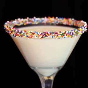 close up Eggnog Martini with colorful sprinkles on the rim