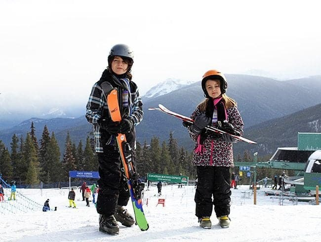 Two kids Skiing At Marmot Basin