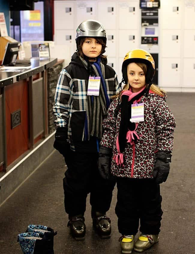 kids with poker faces wearing their skiing gears