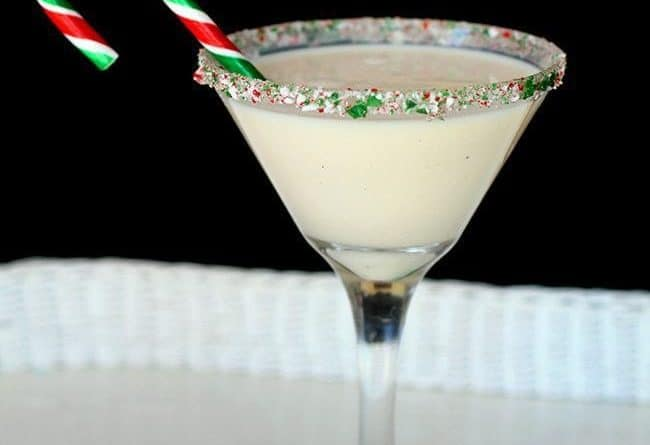 A glass of Peppermint eggnog martini with candy crane