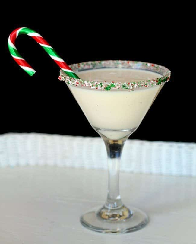 Close up of peppermint eggnog martini with candy crane
