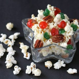 Close up of Christmas Popcorn in with colored cherries and pecans in a Star Shaped Container