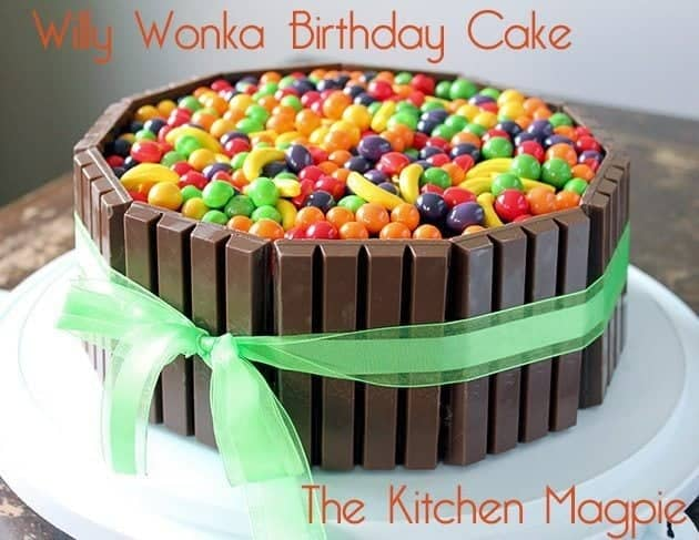 Willy Wonka colorful Cake with KitKat bars and green ribbon