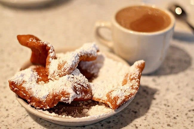 beignets and cafe au lait - half coffee and half milk at Cafe du Monde