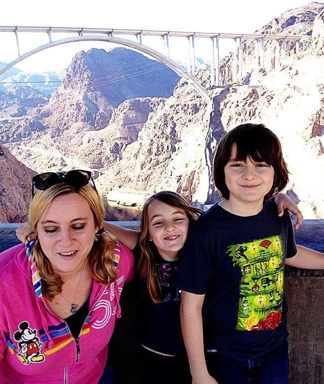 close up groupie with mom and her kids with the Hoover Dam as background