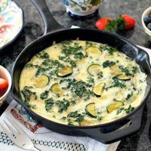 Kale & Zucchini Frittata in large black pan,
