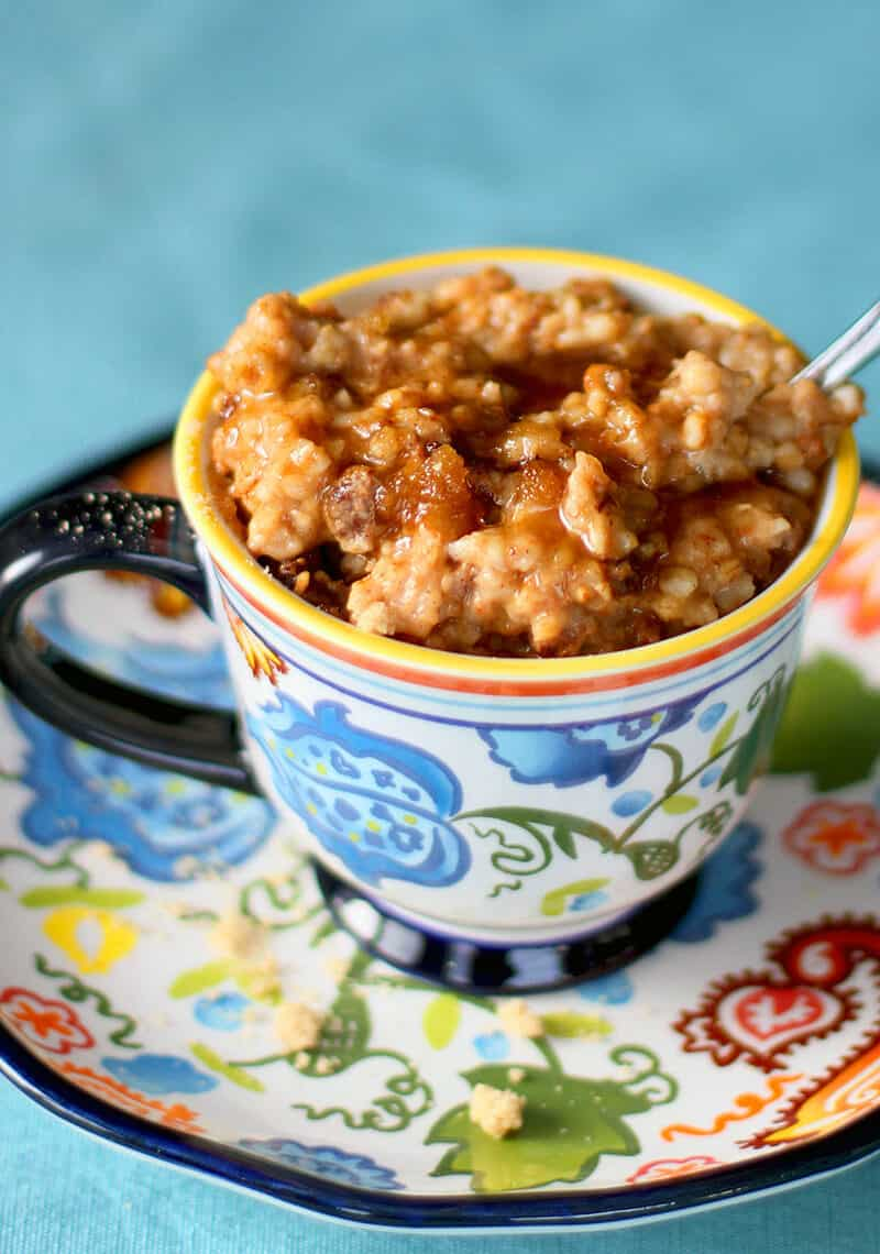 Cinnamon Raisin Slow Cooker Oatmeal topped with maple syrup