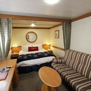 Stateroom 6083 with queen bed and sleeps three, with the pull out sofa couch