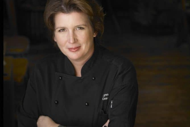CHEF LYNN CRAWFORD - lady chef wearing black chef uniform